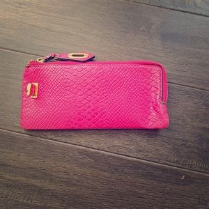 Hot pink clutch wallet.